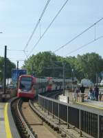 A tram (line 9) is arrriving in  Deutzer Freiheit  in Cologne on August 21st 2013.