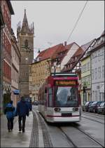 Tram N° 616 is running through Johannesstraße in Erfurt with the Johanneskirchturm in the background on December 26th, 2012.
