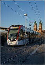 A VAG tram service to Rieselfeld (Linie n&#176; 5) by< the Freiburg Main Station.