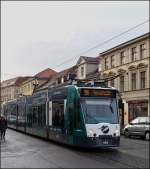 Tram N° 402 is running through Friedrich-Ebert-Straße in Potsdam on December 26th, 2012.