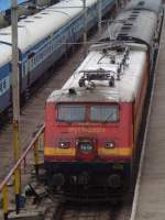 22014 electric locomotive pulling a long distance express is arriving Egmore terminus.