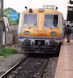 Trailer car of a EMU with a uncommon livery heading towards Egmore