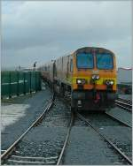 By a heavy rain is a arriving the  IR CC 224 with his Inter City from Dublin in the Galway Station.