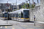 Tram LUAS 3009on  the reds line (The Point-Saggart/Tallaght)in front of The National Museum of Ireland in Dublin. Date: 11 May 2018.