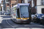 Tram LUAS Citadis 3019 in Bernburb Street of Dublin. The initial 3000 class trams are 30m long Citadis 301 configurations with a capacity of 256. Date: 11 May 2018.
