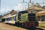 D 245 2123 shunts Swiss stock at Domodossola on 19 May 2006.