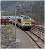 The IR 112 Luxembourg City - Liers is running throught the station of Goebelsmühle on April 14th, 2012.