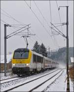 The IR 116 Luxembourg City - Liers is running through the snowy landscape in Enscherange on January 22nd, 2013.