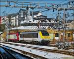 . 4001 is hauling 3012 through the station of Luxembourg City on March 15th, 2013.