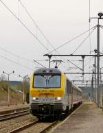 . 3002  Blankenberge  is hauling the IR 112 Luxembourg City - Liers into the station of Gouvy on April 4th, 2014.