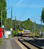 . 3019 is hauling the IR 111 Liers - Luxembourg City into the station of Wilwerwiltz on May 25th, 2014.