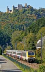 . 3005 is hauling the IR 115 Liers - Luxembourg City through Michelau on October 3rd, 2014.