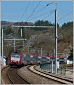 4012 is hauling the IR 3737 Troisvierges - Luxembourg City into the station of Kautenbach on April 3rd, 2012.