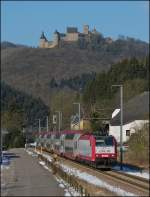 4020 is heading the IR 3737 Troisvierges - Luxembourg City in Michelau with the castle of Bourscheid in the background on February 10th, 2012.
