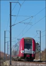 . The RB 4737 Athus (B) - Luxembourg City will soon arrive at the station of Dippach-Reckange on March 4th, 2013.