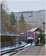 . The RB 3213 Luxembourg City - Wiltz is leaving the station of Kautenbach on March 25th, 2013.
