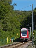 The RB 3209 Luxembourg City - Wiltz is running between Kautenbach and Wiltz on September 9th, 2012.