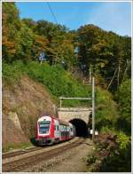The IR 3737 Troisvierges - Luxembourg City is leaving the tunnel in Cruchten on October 19th, 2013.