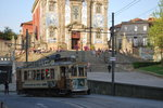 Tramway passing Santo Ildefonso church in Porto (Praça da batalha, April 2015).