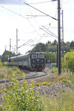 SJ Rc6 1341 on the line from Borlänge to Leksand in Dalarna, Sweden. The black locomotive is well-known as engine on the nicht and regional trains in Sweden. Date: 1. August 2017.