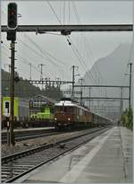 A BLS heritage train with two Ae 6/8 is arriving at Kandersteg.