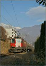 The SBB Re 4/4 II 11148 is approaching Locarno with his IR.