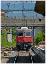 The Re 4/4 II 11122 is entering into the station of Locarno on May 23th, 2012.
