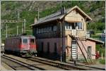 The Re 4/4 II 11608 is running alone through the station of Brig on May 25th, 2012.