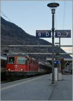 SBB Re 4/4 II 11148 with the IR 1403 to Brig by the stop in Visp.
