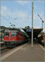 Re 4/4 II 11127 and an other one wiht the IR 2316 Lugano - Basel in Bellinzona.