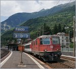 The SBB Re 4/4 II 11245 with an IR to Locarno by his stop in Faido.