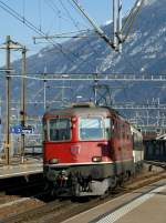 SBB Re 4/4 II is arriving with his IR in the Martigny Station.