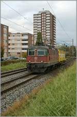 Re 4/4 II 11365 with a mini-mail train by Grenchen.