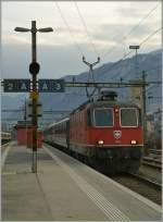 On the place of a SBB Re 460 is this Re 4/4 II 11205 with the IR 1712 from Brig to Geneva airport by the stop in Sion.