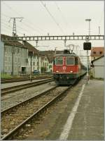 Re 4/4 II 11204 is arriving with his local train to Romont at Payerne.