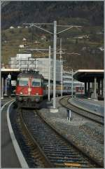 Re 4/4 II 11151 with a RE St Gallen - Chur by his stop in Sargans.
