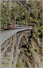 A BLS Re 4/4 wiht the EC 90  Vauban  on the Bietschtal Bridge.