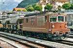 With a works train from the construction base of the Lötschberg Base Tunnel, BLS 179 enters Spiez on 22 July 2000.
