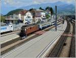 A BLS Re 4/4 is pushing a local train to Interlaken out of the station of Spiez on August 6th, 2007.