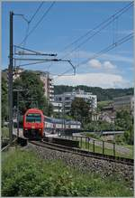 A SBB Re 450 by the Neuhausen Rhienfall Station.