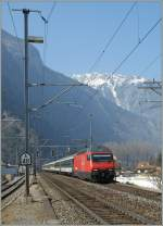 The SBB Re 460 061-5 is arriving with an IR at Martigny Station.