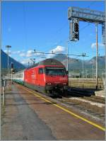 The SBB Re 460 wiht his EC to Milan is arriving at Domodossola.