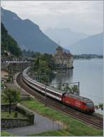 A SBB Re 460 with his IR n the way to Geneva by the Chastle of Chillon.