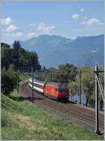 The SBB Re 460 079-7 with an IR90 to Geneva Airport near Villeneuve.