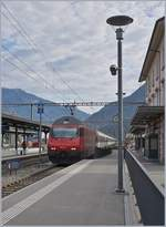 The SBB Re 460 001-1 with a IC to Lugano in Giubisaco.