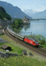 SBB Re 460 wiht an IR service to Geneva by the Castle of Chillon.