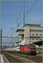 The SBB Re 460 038-3 is arriving at Lausanne with his IC from Geneva to St Gallen.