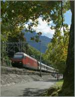 The SBB Re 460 017-7 by the Castle of Chillon.