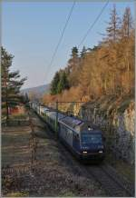 The BLS Re 465 010 with a RE from La Chaux de Fonds to Bern near Chambrelien.