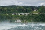 A Re 6/6 wiht a Cargo train by Neuhausen near the Rheinfall.